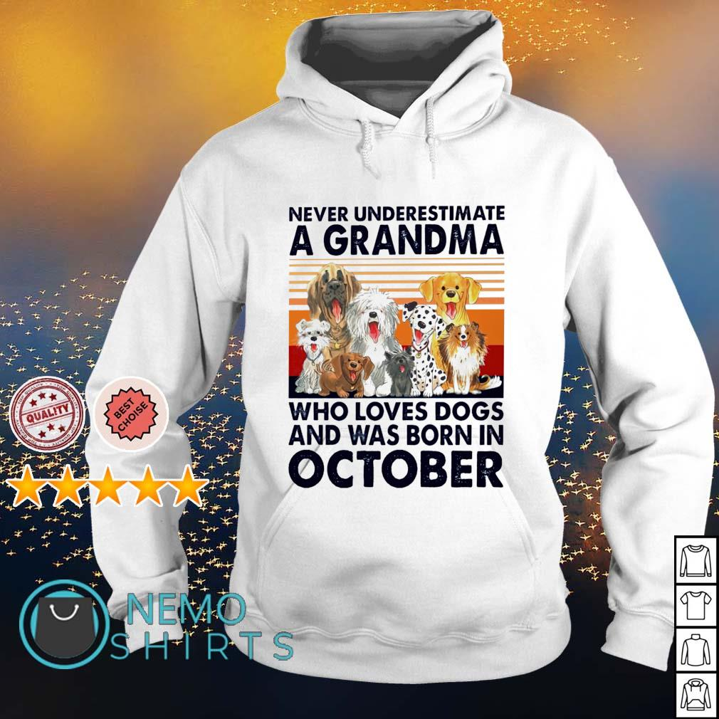 Never underestimate a grandma loves dogs and was born in October s hoodie