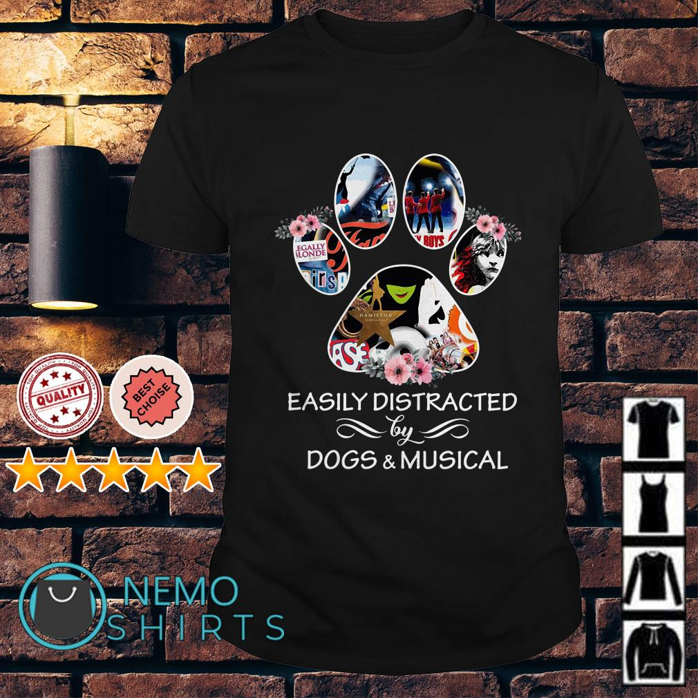 Dog paw easily distracted by dogs and musical shirt