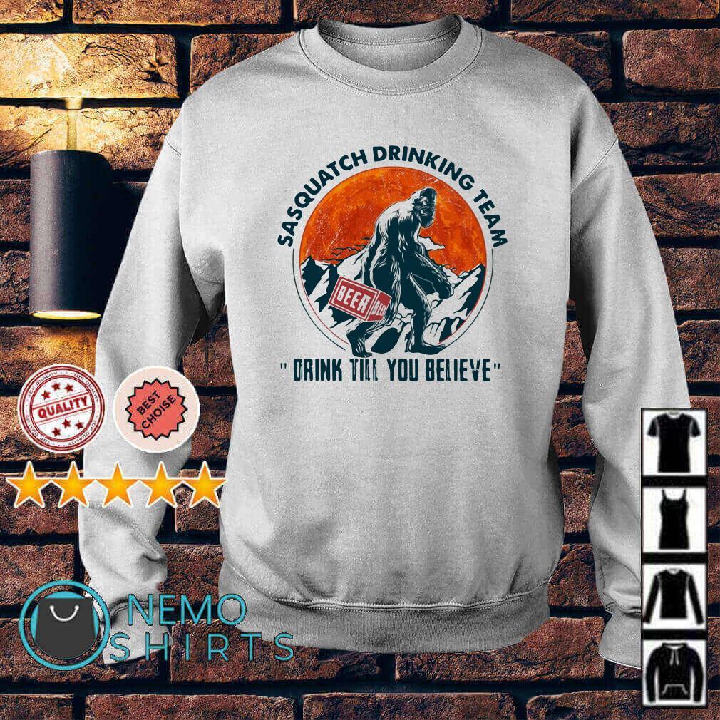Bigfoot sasquatch drinking team drink till you believe Sweater